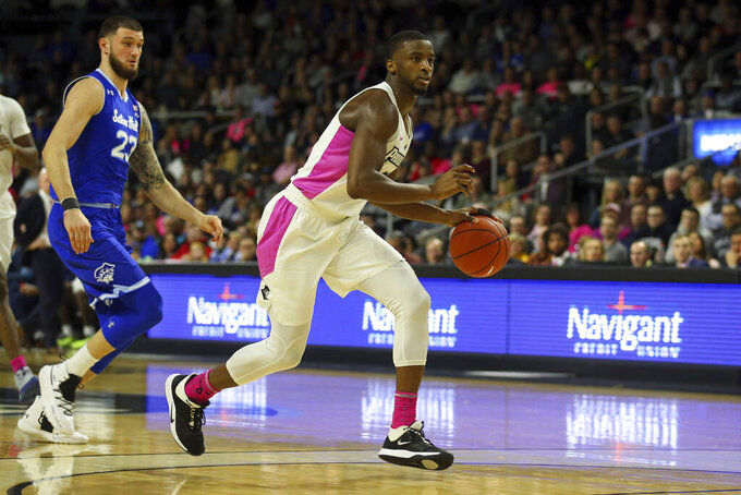 Providence's Alpha Diallo, right, dribbles during the second half of an NCAA college basketball game against Seton Hall, Saturday, Feb. 15, 2020, in Providence, R.I. (AP Photo/Stew Milne)