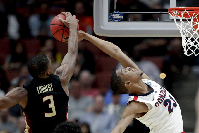 Florida State guard Trent Forrest, left, blocks a shot by Gonzaga guard Zach Norvell Jr. during the second half an NCAA men's college basketball tournament West Region semifinal Thursday, March 28, 2019, in Anaheim, Calif. (AP Photo/Jae C. Hong)