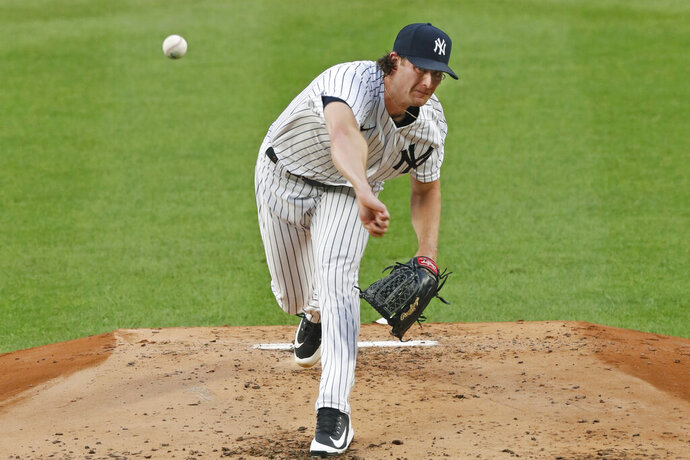 New York Yankees starting pitcher Gerrit Cole delivers during the second inning of a baseball game against the Philadelphia Phillies, Monday, Aug. 3, 2020, at Yankee Stadium in New York. (AP Photo/Kathy Willens)
