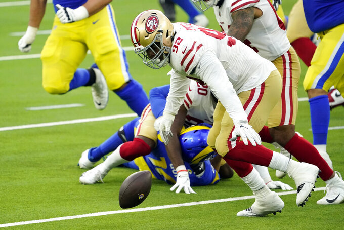 San Francisco 49ers defensive end Kerry Hyder (92) recovers a fumble by Los Angeles Rams quarterback Jared Goff during the first half of an NFL football game Sunday, Nov. 29, 2020, in Inglewood, Calif. (AP Photo/Alex Gallardo)