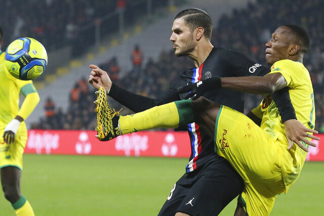 Nantes' Charles Traore, center right, gets to the ball before PSG's Mauro Icardi during the League One soccer match between Nantes and Paris-Saint-Germain, in Nantes, western France, Tuesday, Feb. 4, 2020. (AP Photo/David Vincent)