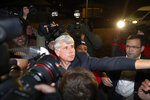 Former Illinois Gov. Rod Blagojevich tries to get into his house as he arrives home in Chicago on Wednesday, Feb. 19, 2020, after his release from Colorado prison late Tuesday. Blagojevich walked out of prison Tuesday after President Donald Trump cut short the 14-year prison sentence handed to the former Illinois governor for political corruption. (AP Photo/Charles Rex Arbogast)