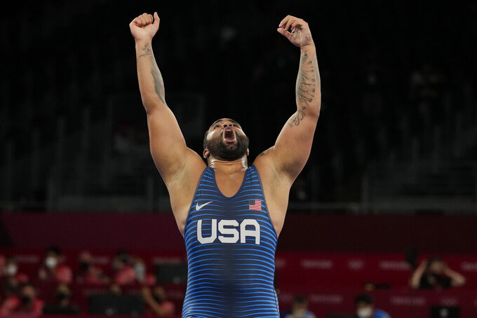 United State's Gable Dan Steveson celebrates after defeating Georgia's Gennadij Cudinovic during their men's freestyle 125kg wrestling final match at the 2020 Summer Olympics, Friday, Aug. 6, 2021, in Chiba, Japan. (AP Photo/Aaron Favila)