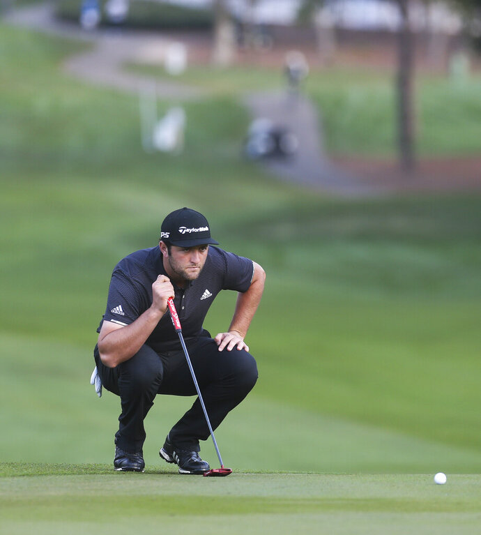 Jon Rahm lines up a putt on the first hole during the first round of the Valspar Championship golf tournament in Palm Harbor, Fla., Thursday, March 21, 2019. (Dirk Shadd/Tampa Bay Times via AP)