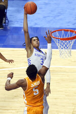 Kentucky's B.J. Boston, top, goes for a dunk while defended by Tennessee's Josiah-Jordan James (5) during the second half of an NCAA college basketball game in Lexington, Ky., Saturday, Feb. 6, 2021. (AP Photo/James Crisp)