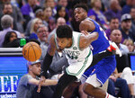 Boston Celtics guard Marcus Smart, left, scrambles for the ball against Sacramento Kings guard Buddy Hield, right, during the first half of an NBA basketball game in Sunday, Nov. 17, 2019. (AP Photo/Rich Pedroncelli)