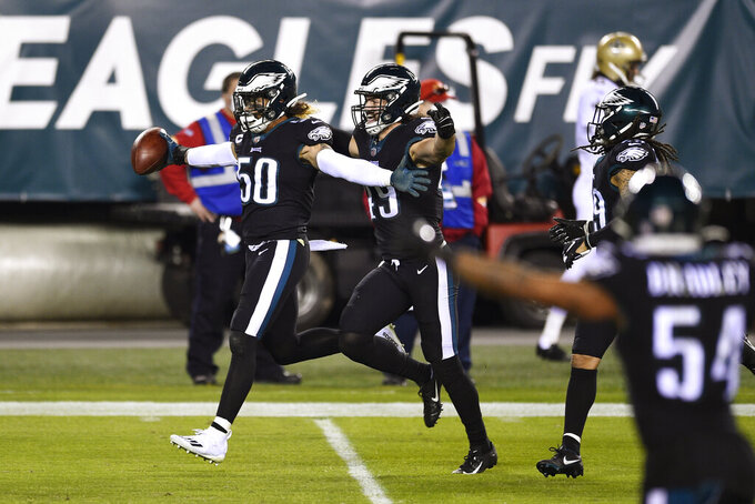 Philadelphia Eagles' Duke Riley (50) reacts after intercepting a pass by New Orleans Saints' Taysom Hill during the first half of an NFL football game, Sunday, Dec. 13, 2020, in Philadelphia. (AP Photo/Derik Hamilton)