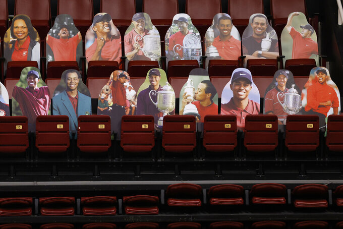 Section of cutouts of Stanford Alumni Tiger Woods before an NCAA college basketball game Oregon State Beavers in Stanford, Calif., Saturday, Feb. 27, 2021. (AP Photo/Josie Lepe)