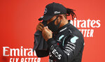 Mercedes driver Lewis Hamilton of Britain after the qualifying session at the 70th Anniversary Formula One Grand Prix at the Silverstone circuit, Silverstone, England, Saturday, Aug. 8, 2020. (Bryn Lennon, Pool Photo via AP)