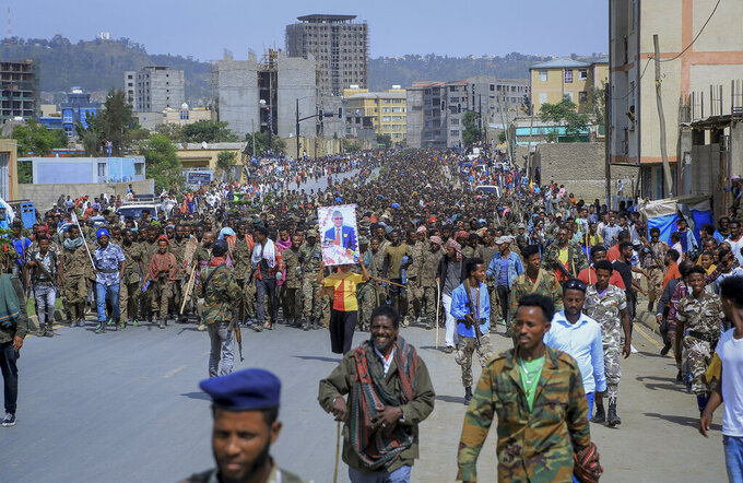 FILE - In this Friday July 2, 2021 file photo, captured members of the Ethiopian National Defense Force are marched through the streets to prison under guard by Tigray Forces as hundreds of residents look on, in Mekele, in the Tigray region of northern Ethiopia. Samantha Power, the U.S. official who wrote a Pulitzer Prize-winning book on genocide is visiting Ethiopia next week to press the government to lift what the U.S. calls a blockade on humanitarian aid to the conflict-hit Tigray region, where hundreds of thousands of people now face deadly famine. (AP Photo/File)