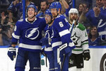 Tampa Bay Lightning's Ondrej Palat, of the Czech Republic, Tyler Johnson, and Anton Stralman, of Sweden, celebrate a goal as Dallas Stars' Andrew Cogliano reacts during the first period of an NHL hockey game Thursday, Feb. 14, 2019, in Tampa, Fla. (AP Photo/Mike Carlson)