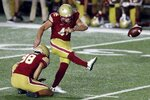 Boston College's Aaron Boumerhi (41) kicks the go-ahead field goal in the waning seconds of the team's NCAA college football game against Texas State, Saturday, Sept. 26, 2020, in Boston. (AP Photo/Michael Dwyer)