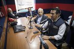 """Wilson Florez, candidate of Democratic Center political party for the government of Cundinamarca, speaks at a radio station during an interview in Bogota, Colombia, Wednesday, Oct. 23, 2019. Despite an historic peace accord, running for office in Colombia is still a risky proposition. In recent months, two candidates were shot and burned to death in a campaign vehicle. Flores has received a menacing pamphlets declaring him a """"military target."""" (AP Photo/Ivan Valencia)"""