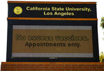 """A digital sign reads """"No excess vaccines. Appointments Only,"""" outside the California State University, Los Angeles campus in Los Angeles Thursday, April 8, 2021. A mass vaccination site at California State University, Los Angeles announced it would take adults on a walk-up basis because of excess appointments. But by late Thursday morning, the site was turning people away because of demand. California Office of Emergency Services spokesman Brian Ferguson said in an email to The Associated Press on Thursday that advance registration through the state's My Turn system is the only way to guarantee a vaccination there. (AP Photo/Damian Dovarganes)"""