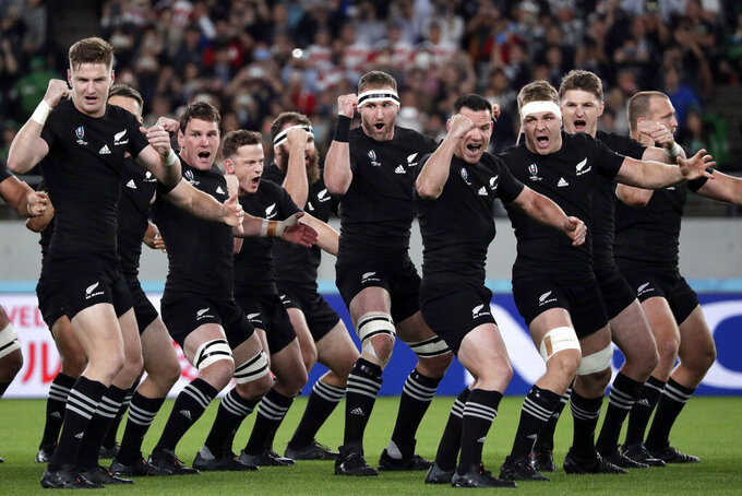 FILE - In this Nov. 1, 2019, file photo, New Zealand players perform the haka before the Rugby World Cup bronze final game at Tokyo Stadium in Tokyo, Japan. New Zealand Rugby will face a momentous decision on the future of the All Blacks at its annual meeting Thursday, April 29, 2021, when it debates whether to sell a stake in the commercial value of the national team to American investors. (AP Photo/Aaron Favila, File)