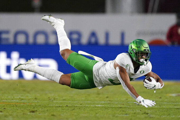 Oregon wide receiver Johnny Johnson III (3) catches a pass during the second quarter of an NCAA college football game for the Pac-12 Conference championship against Southern California Friday, Dec 18, 2020, in Los Angeles. (AP Photo/Ashley Landis)
