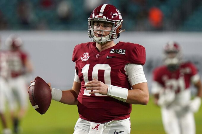 Alabama quarterback Mac Jones watches during warm ups before an NCAA College Football Playoff national championship game against Ohio State, Monday, Jan. 11, 2021, in Miami Gardens, Fla. (AP Photo/Chris O'Meara)