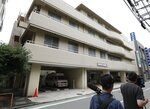 This July 7, 2018 photo shows the hospital where suspect Ayumi Kuboki worked in Yokohama. Japanese authorities raided Thursday, July 12, 2018, the apartment of the nurse who was arrested on suspicion of poisoning to death at least two elderly patients at the terminal care hospital. (Kyodo News via AP)