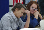 Judges Betsy Benson, left, and Deborah Carpenter Toye, of the canvassing board, react to an 11th hour paperwork delay, Sunday, Nov. 18, 2018, at the Broward Supervisor of Elections office in Lauderhill, Fla. Broward County reported their recount results with 52 minutes to spare Sunday. (Joe Cavaretta/South Florida Sun-Sentinel via AP)