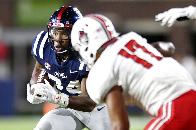 Mississippi running back Snoop Conner (24) runs against Austin Peay during an NCAA college football game in Oxford, Miss., Saturday, Sept. 11, 2021. (AP Photo/Bruce Newman)