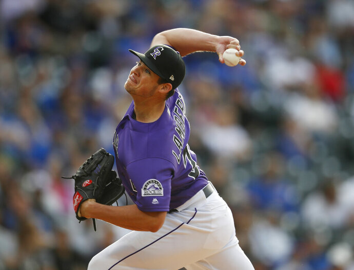 Colorado Rockies starting pitcher Peter Lambert works against the Chicago Cubs in the first inning of a baseball game Tuesday, June 11, 2019, in Denver. (AP Photo/David Zalubowski)