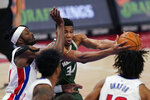 Milwaukee Bucks forward Giannis Antetokounmpo (34) is fouled by Detroit Pistons forward Jerami Grant during the first half of an NBA basketball game, Wednesday, Jan. 13, 2021, in Detroit. (AP Photo/Carlos Osorio)