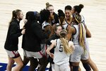 UConn players celebrate after an NCAA college basketball game against Baylor in the Elite Eight round of the Women's NCAA tournament Monday, March 29, 2021, at the Alamodome in San Antonio. UConn won 69-67 to advance to the Final Four. (AP Photo/Morry Gash)