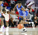 Kentucky guard Ashton Hagans (2) and Georgia guard Tyree Crump (4) chase down a loose ball during the first half of an NCAA college basketball game Tuesday, Jan. 15, 2019, in Athens, Ga. (AP Photo/John Bazemore)