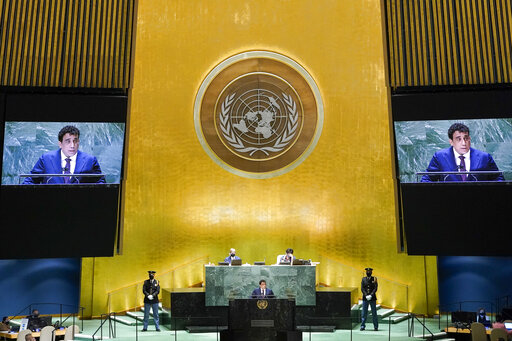 Libya's President Mohamed Younis Menfi addresses the 76th Session of the United Nations General Assembly, Thursday, Sept. 23, 2021 at U.N. headquarters. (AP Photo/Mary Altaffer, Pool)
