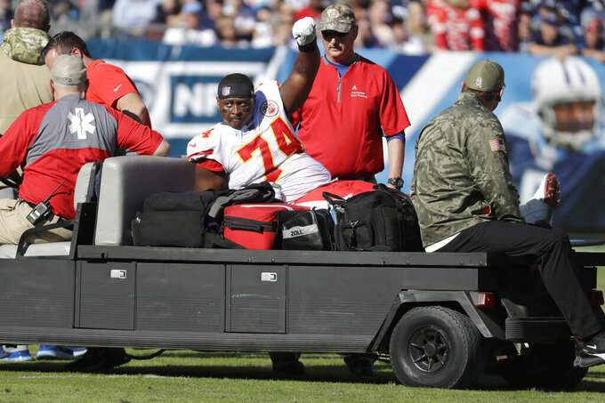 Kansas City Chiefs offensive guard Martinas Rankin is taken off the field after being injured in the first half of an NFL football game against the Tennessee Titans Sunday, Nov. 10, 2019, in Nashville, Tenn. (AP Photo/James Kenney)