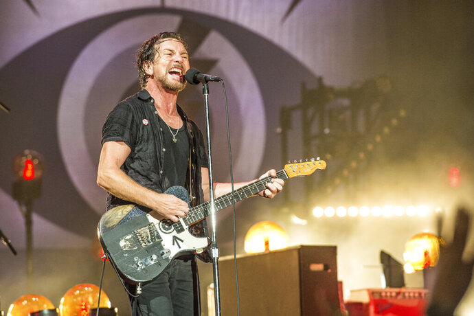 FILE - Eddie Vedder of Pearl Jam performs at Bonnaroo Music and Arts Festival in Manchester, Tenn. on June 11, 2016. Pearl Jam has encouraged fans to vote and asks them to take a pledge to try and mail-in their ballots. Vedder posted step-by-step photos on his Instagram page on how to vote by mail.  (Photo by Amy Harris/Invision/AP, File)