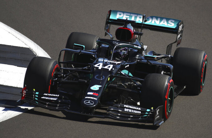 Mercedes driver Lewis Hamilton of Britain steers his car during a practice session at the 70th Anniversary Formula One Grand Prix at the Silverstone circuit, Silverstone, England, Friday, Aug. 7, 2020. (Bryn Lennon, Pool Photo via AP)
