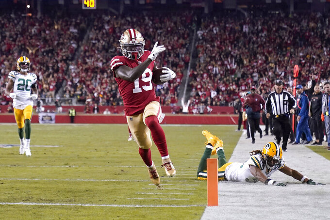 San Francisco 49ers wide receiver Deebo Samuel (19) runs toward the end zone to score against the Green Bay Packers during the first half of an NFL football game in Santa Clara, Calif., Sunday, Nov. 24, 2019. (AP Photo/Tony Avelar)