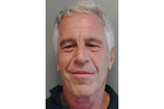 FILE - This July 25, 2013, file image provided by the Florida Department of Law Enforcement shows financier Jeffrey Epstein. A previously undisclosed federal investigation into Epstein included an examination of whether he was traveling with underage girls as recently 2018, newly released documents show. Epstein killed himself in jail in August 2019 while awaiting trial on sex trafficking charges. (Florida Department of Law Enforcement via AP, File)