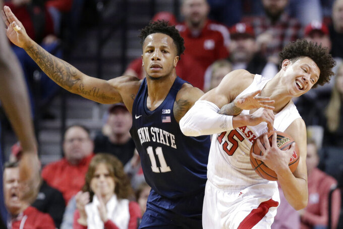 Nebraska's Isaiah Roby (15) grabs the ball away from Penn State's Lamar Stevens (11) during the first half of an NCAA college basketball game in Lincoln, Neb., Thursday, Jan. 10, 2019. (AP Photo/Nati Harnik)