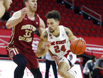 North Carolina State's Devon Daniels (24) drives by Boston College's James Karnik (33) during the first half of an NCAA college basketball game in Raleigh, N.C., Wednesday, Dec. 30, 2020. (Ethan Hyman/The News & Observer via AP, Pool)