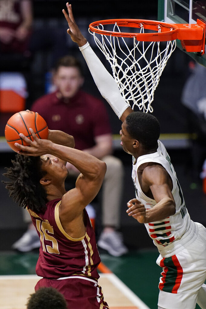Boston College guard DeMarr Langford Jr. (15) shoots as Miami forward Anthony Walker defends during the second half of an NCAA college basketball game Friday, March 5, 2021, in Coral Gables, Fla. (AP Photo/Wilfredo Lee)