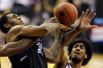 Saint Louis' Jimmy Bell Jr., left, and Kansas State's Antonio Gordon battle for a rebound during the second half of an NCAA college basketball game Saturday, Dec. 21, 2019, in Kansas City, Mo. (AP Photo/Charlie Riedel)