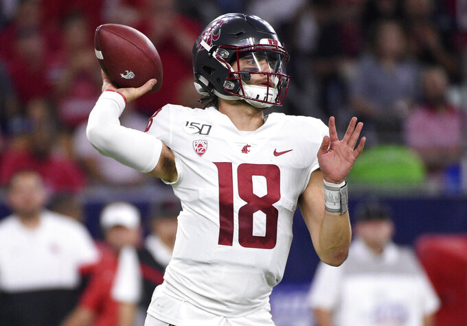 Washington State quarterback Anthony Gordon throws a pass during the first half of the team's NCAA college football game against Houston, Friday, Sept. 13, 2019, in Houston. (AP Photo/Eric Christian Smith)