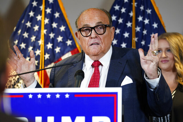 FILE - In this Nov. 19, 2020, file photo, former New York Mayor Rudy Giuliani, a lawyer for President Donald Trump, speaks during a news conference at the Republican National Committee headquarters, in Washington. Giuliani urged Michigan Republican activists on Wednesday, Nov. 2, 2020, to pressure the GOP-controlled Legislature to