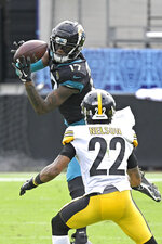 Jacksonville Jaguars wide receiver DJ Chark Jr. (17) makes a reception in front of Pittsburgh Steelers cornerback Steven Nelson (22) during the first half of an NFL football game, Sunday, Nov. 22, 2020, in Jacksonville, Fla. (AP Photo/Phelan M. Ebenhack)