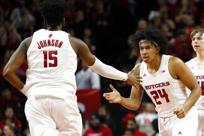 Rutgers guard Ron Harper Jr. (24) celebrates with center Myles Johnson during the second half of an NCAA college basketball game against Illinois, Saturday, Feb. 15, 2020, in Piscataway, N.J. (AP Photo/Adam Hunger)