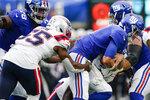 New England Patriots' Josh Uche (55) sacks New York Giants quarterback Daniel Jones during the first half of an NFL preseason football game Sunday, Aug. 29, 2021, in East Rutherford, N.J. (AP Photo/John Minchillo)