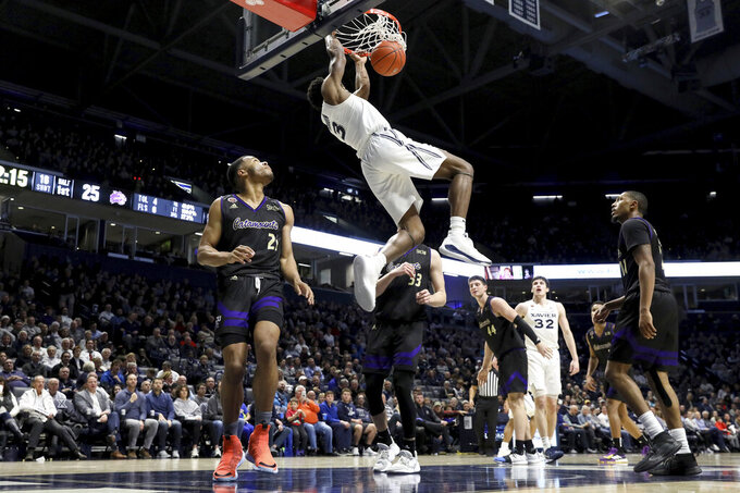 Xavier guard Quentin Goodin (3) dunks during the first half of an NCAA college basketball game against Western Carolina, Wednesday, Dec. 18, 2019 in Cincinnati. (Kareem Elgazzar/The Cincinnati Enquirer via AP)