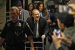 Harvey Weinstein leaves court in his rape trial, in New York, Wednesday, Jan. 22, 2020. (AP Photo/Richard Drew)
