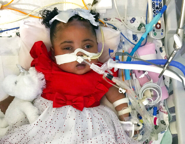 FILE - This Dec. 25, 2019, file photo provided by Texas Right to Life shows Tinslee Lewis. A Texas appeals court ruled Friday, July 24, 2020, that a hospital must keep the 17-month-old girl on life support pending a trial addressing the merits of the law doctors invoked to withdraw life-sustaining treatment. (Lewis Family/Texas Right to Life via AP)