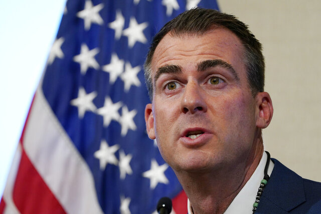 FILE - In this Sept. 22, 2020 file photo, Oklahoma Gov. Kevin Stitt speaks during a news conference in Oklahoma City. Stitt is taking issue with a comment in the latest report from the White House Coronavirus Task Force that says the state has had