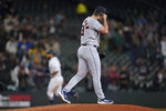 Houston Astros relief pitcher Kendall Graveman reacts on the mound as Seattle Mariners' Abraham Toro run the bases on a grand slam during the eighth inning of a baseball game Tuesday, Aug. 31, 2021, in Seattle. (AP Photo/Ted S. Warren)