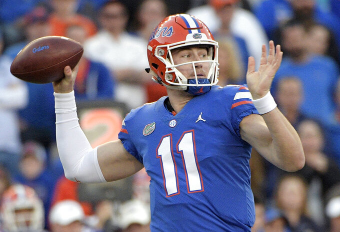 FILE - In this Nov. 3, 2018, file photo, Florida quarterback Kyle Trask throws a pass during the second half of an NCAA college football game against Missouri in Gainesville, Fla. The father of Florida quarterback Kyle Trask says his son is out for the season because of a broken foot. Michael Trask posted on Facebook that Kyle fractured a foot practicing a trick play Wednesday, Nov. 7, 2018. (AP Photo/Phelan M. Ebenhack)