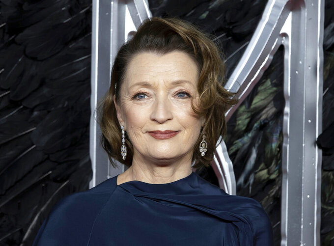 "FILE - In this Oct. 9, 2019 file photo, actress Lesley Manville appears at the premiere of the film ""Maleficent Mistress of Evil"" in London. The Queen's New Year honors list was announced Wednesday, Dec. 30, 2020. Actress Lesley Manville, an Oscar nominee for ""Phantom Thread,"" was named a Commander of the Order of the British Empire, or CBE. Actor Toby Jones, whose credits include Dobby in the ""Harry Potter"" movies, was made an Officer of the Order of the British Empire or OBE, as was writer Jed Mercurio, creator of gripping TV detective series ""Line of Duty.""  (Photo by Grant Pollard/Invision/AP, File)"